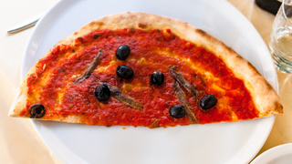 half of pizza with anchovies