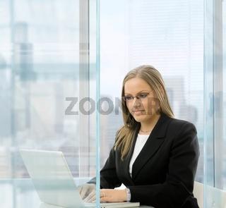 Businesswoman using laptop comouter