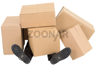 Male feet under a heap of boxes