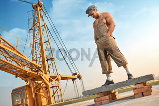 Man standing on concrete construction on high.