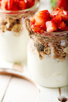 Strawberries desert with cream and cereals