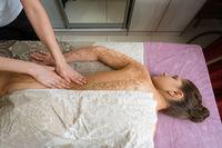 Top view of girl getting procedure body scrub