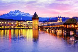 Chapel bridge, Water tower and Mount Pilatus on sunset, Lucerne, Switzerland.