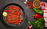 Wiener Sausages in a pan on black background