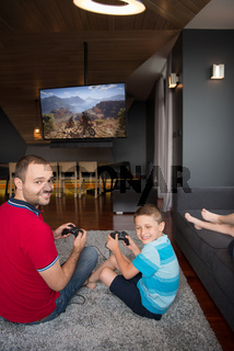 Happy family playing a motocross video game