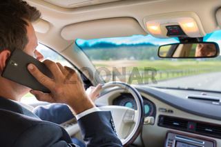 Man using cell phone while driving