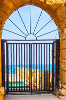 Lattice gates closed arched doorway of the port