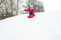 Girl having fun in winter outdoor