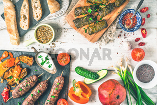 Kebabs with dolma, seasoning and vegetable. Concept Middle east , Asian and Caucasian cuisine top view