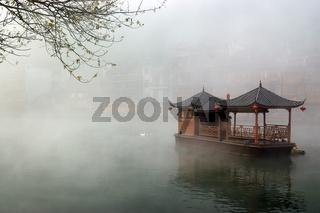 China landscape of boat on foggy river
