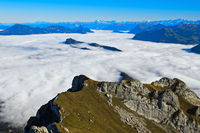 View from the Pilatus massif on the Bürgenstück mountain range in the sea of fog over Lake Lucerne
