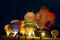 KIEL, GERMANY - JUNI 22, 2016: Glowing Hot Air Balloons in the Night Glow on the 10. International Balloon Sail in Kiel, Germany.