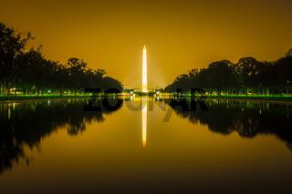 washington memorial tower reflecting in reflective pool at sunset