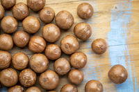 macadamia nuts on rustic wood