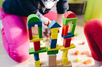 children playing with colorful wooden blocks