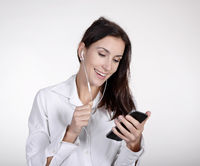 businesswoman with smartphone and headphones