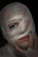 Injured woman with head bandage