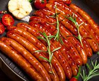 Closeup of Wiener Sausages in a pan
