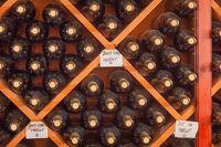 Several Varietal Wine Bottles Age Inside Cellar