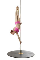 Pole dance. Flexible girl posing while exercising