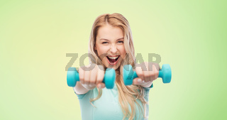 smiling beautiful young sporty woman with dumbbell
