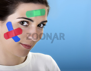 Woman with bandages on the face