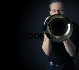 Dark portrait of a brass musician