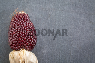 stone background with strawberry corn