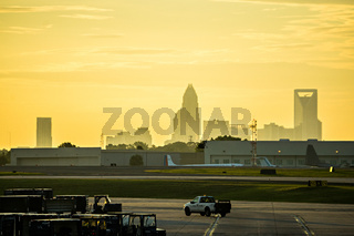 sun rising early morning over charlotte skyline seen from clt airport