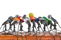 Microphones of different mass media, radio, tv and press prepared for conference meeting. Press conference or interview concept.