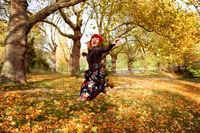 Women jumpIng in autumn Park