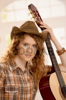 Attractive girl with guitar
