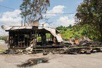 Burned ruins of wooden frame home