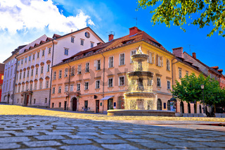 City of Ljubljana fountain on sun beams and street architecture view