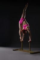 Tightrope walker training. Photo on gray backdrop