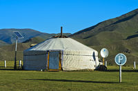 Modern yurt with solar panel, satellite dish and parking lot, Orkhon Valley, Mongolia