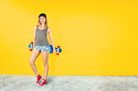 Beautiful young woman with skateboard