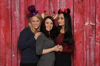 3 girls have fun with a photo box