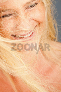 pretty young blonde woman with her hair tangled up