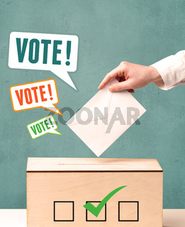 placing a voting slip into a ballot box