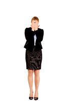 Troubled business woman covering her face with hands