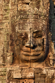 Giant stone face at Bayon Temple in Cambodia