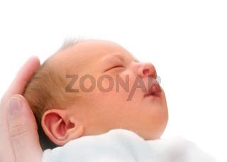Newborn in fathers hand