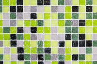 Background from green, black and grey mosaic tiles