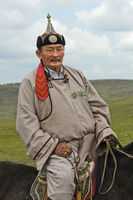 Portrait, elderly male nomad in traditional dress, Mongolia