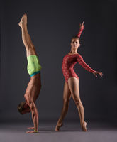 Studio photo of sports gymnasts posing at camera
