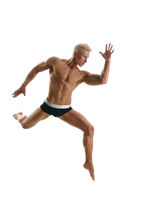 Blond athlete poses during jump. Isolated on white