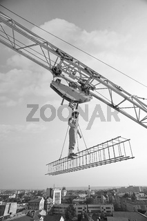Professional builder dressed in vintage outfit posing on a cross