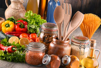 Composition with assorted food products and kitchen utensils on the table