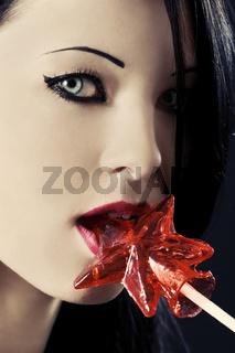 Portrait of girl holding big lollipop.